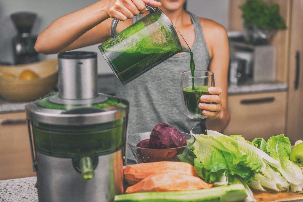 Woman drinking green juice