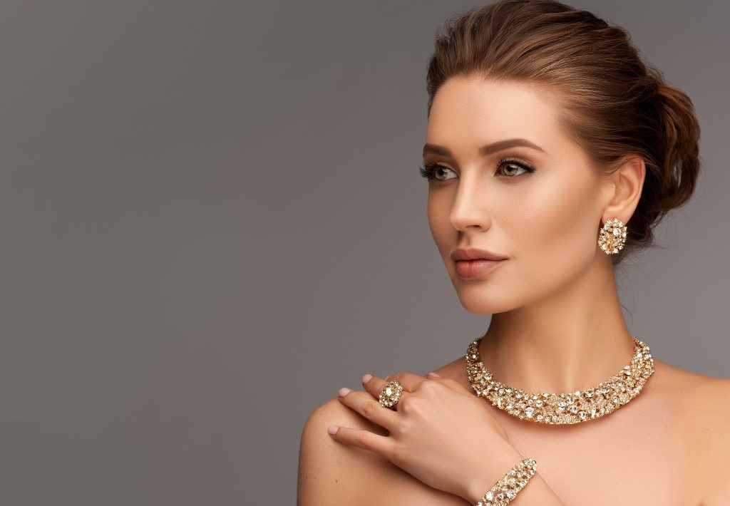 woman posing with jewelry
