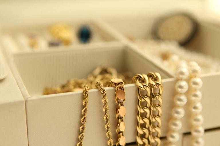 gold chains and pearls in a box