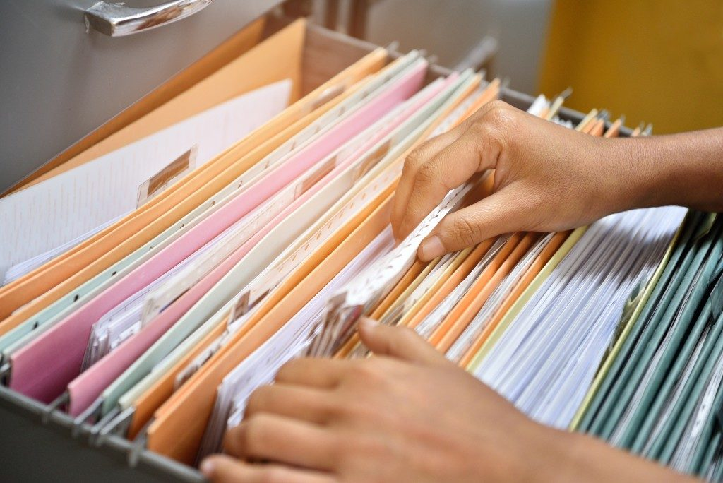 folders filed in a storage box