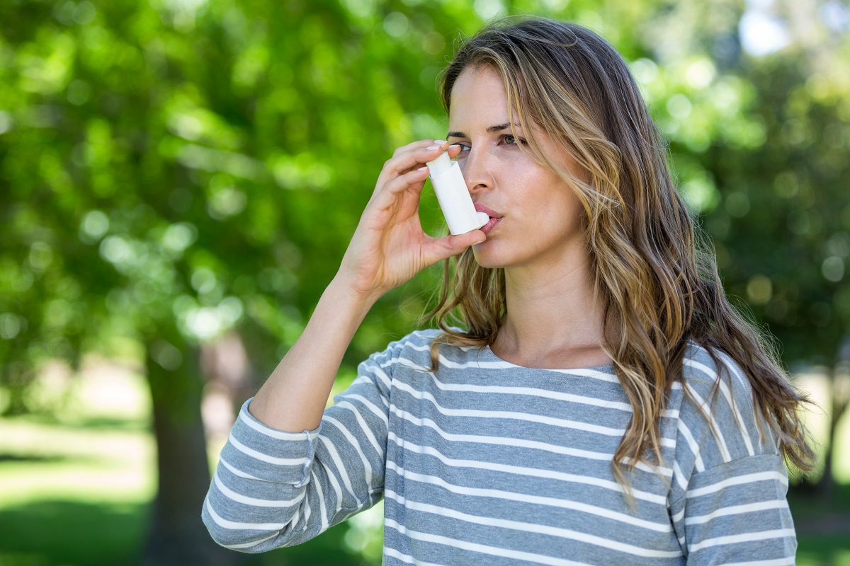 Female using an inhaler