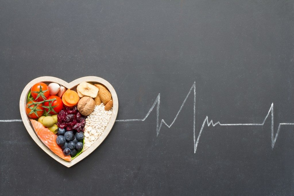 healthy food in heart-shaped bowl
