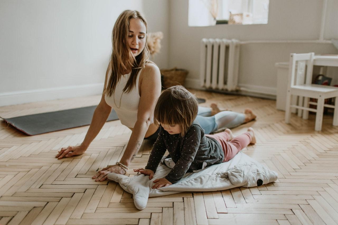 mom and child doing yoga together