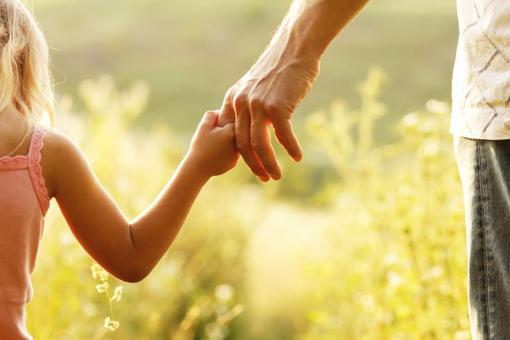 holding child's hand