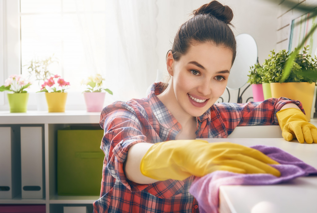 woman cleaning a countertop