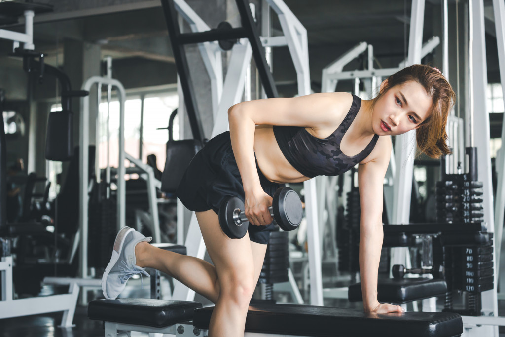 woman working out in home gym